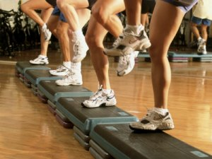 low-section-view-of-a-group-of-people-exercising-in-a-step-aerobics-class
